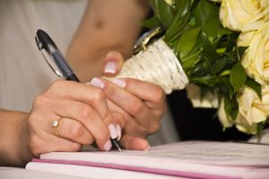 signing marriage cerfificate